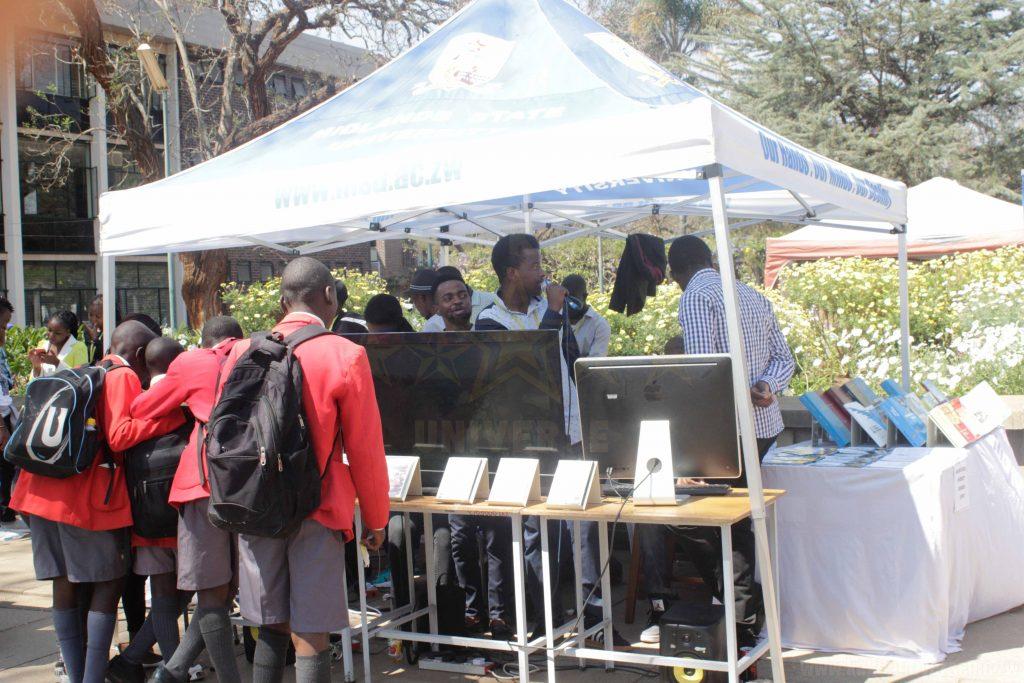 Children watching Jah Kaylite at GIBF